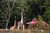 dinosaurs at the entrance to the representation of hell, wat keaw prasert, pathio, province of chumphon, thailand, asia