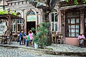 cafe bar palabahce kahvehanesi on the street 13 nissan, city of ayvalik on the shores of the aegean sea, the olive riviera, north of izmir, turkey