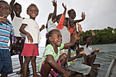People of Telina Island welcome Visitors, Marovo Lagoon, Solomon Islands