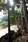 Tourists on the volcanic rock coast, Kalapathar (black stone), uninhabited, East Coast, northern Can Hat Bay, Little Andaman, Andaman Islands, Union Territory, India