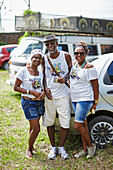 Alberico with two friends, participants of the Samba No Ver De Trem, in front of sound system VW Bus, Samba fans and musicians hire a local train and go partying, Sunday, Salvador de Bahia, Bahia, Brazil