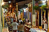 Restaurants with tables the street, Rua das Pedres, the center of Lencois, the main town, starting point for Chapada Diamantina National Park, Bahia, Brazil