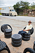 Helio Barbosa, 80 years, former prospector,  Garimpeiro, furniture made from old tires on BR-242, gift shopand restaurant Cabana do Louro, at Posso do Diabo Waterfall, northern border of the Chapada Diamantina National Park, Bahia, Brazil