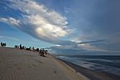 Duna do Por do Sol (Sunset Dune), tourists in the evening on a dune at the beach, Jericoacoara National Park, near Jericoacoara, Ceara, Brazil