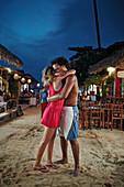 Brazilian couple on the Main Road, all roads are made of sand, Jericoacoara, Ceara, Brazil