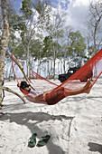Hammocks for tourists, ride with 4WD with guide Paulo Extremo Nordeste Xpeditions, mangrove forest, road on the beach near the village of Vila do Pescadores, west Jericoacoara, Ceara, Brazil