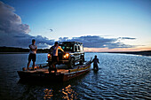 Ferry across the river, road on the beach near the village of Vila do Pescadores, Land Rover of Extremo Nordeste Xpeditions, west Jericoacoara, Ceara, Brazil