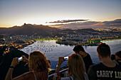 Visitors taking pictures, view from Sugar Loaf Mountain to the west, over Enseada de Botafogo bay, Rio de Janeiro, Rio de Janeiro, Brazil