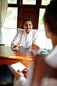 Dr. Jouhar Kanhirala explaining the Ayurvedic treatment, Ayurvedic Hospital and luxury hotel Kalari Kovilakom, Kollengode, near Palakkad, Western Ghats, Kerala, India