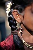 Typical girls hairdo, glossy from coconut oil, Sri Vinayagar temple festival, annual Hindu festival in the village of Nadukahni, northwest of the Nilgiri Hills (Ooty), Western Ghats, Tamil Nadu, India