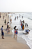 Families in the evening on the western beach of Fort Cochin, near Dutch Cemetery, Fort Kochi, Cochin, Kerala, India
