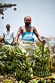Dealer unloading his truck at the market in Conoor, Nilgiri Hills, Western Ghats, Tamil Nadu, India