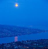 Full moon over lake Zurich and Zurich at night, Zurich, Switzerland