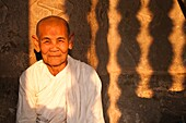 Camdodia, Siem Reap Province, Siem Reap Town, Angkor Temples, Site World Heritage of Humanity by Unesco in 1992, Angkor Wat temple (12th century), a nun