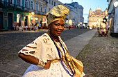 Afro-Brazilian woman wearing traditional Bahian dresses in Salvador da Bahia, the city of the Holy Saviour of the Bay of all Saints on the northeast coast of Brazil , South America
