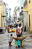 Street vendor in Salvador da Bahia, the city of the Holy Saviour of the Bay of all Saints on the northeast coast of Brazil , South America