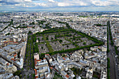 Europe, France, Paris, aerial view of Montparnasse Cemetery, Avenue du Maine on the right