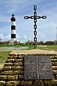 France, Charente Maritime, Oleron Island, Saint-Denis d'Oleron, plaque and cross in memory of dead sailors at sea before Chassiron lighthouse at the tip of the island