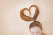 Ponytail of Caucasian girl in heart shape