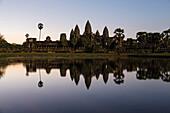 Temple reflecting in still lake, Siem Reap, Siem Reap, Cambodia