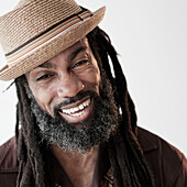 Close up of Black man with dreadlocks laughing