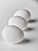 Close up of three white eggs
