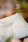 Close up of wedding rings on ring pillow