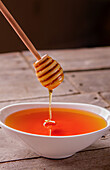 Honey Dripping into Bowl