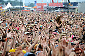 cheering fans at an outdoor rock concert, Rock am Ring, Nuerburgring, Nuerburg, Germany