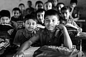 Boy in a school class in Munshiganji, Bangladesh