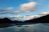 Mountains over remote river, Glenorchy, South Westland, New Zealand