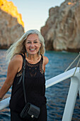 Older Caucasian woman smiling on boat