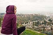 Caucasian woman admiring scenic view of cityscape, Granada, Spain