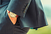 Close up of hand in pocket of Caucasian businessman