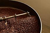 Coffee beans roasting in industrial kettle