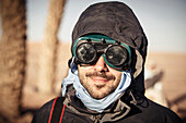 Caucasian traveler wearing goggles and gear
