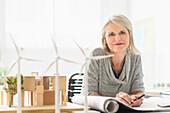 Older Caucasian architect sitting in office