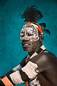 Black man wearing traditional body paint