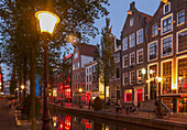 Illuminated streetlights on Amsterdam canal street, Netherland