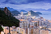 Twilight, illuminated view of Copacabana, the Morro de Sao Joao and the Atlantic coast of Rio, Rio de Janeiro, Brazil, South America