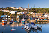 Fishing boats and yachts moored in Mevagissey harbour, Cornwall, England, United Kingdom, Europe