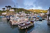 Boats moored in pretty Polperro harbour, Cornwall, England, United Kingdom, Europe