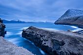Night time descends over Gjogv on the island of Eysturoy, Faroe Islands, Denmark, Europe