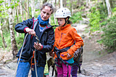 Mother showing daughter how to make a knot, climbing area, Saxony Switzerland, Elbe sandstone mountains, Dresden, Saxony, Germany, Europe