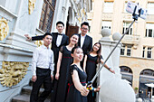 Young Chinese taking pictures of themselves, selfie, stairs, Alte Boerse, Chinese choir at the Bachfest Leipzig 2015, Bach Academy, Leipzig, Saxony, Germany