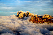 Aerial shot from Seceda of Odle surrounded by clouds at sunset in the Dolomites, Val Funes, Trentino-Alto Adige South Tyrol, Italy, Europe