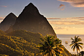 sunset with view  to sea, sailing ship and volcano mountains The Pitons with Gros and Petit Piton, Pitons Bay, UNESCO world heritage, Soufriere, St. Lucia, Saint Lucia, Lesser Antilles, Westindies, Windward Islands, Antilles, Caribbean, Central America