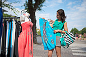 Woman with shopping bags, Bibione, Venice, Veneto, Italy