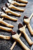 Two Rows of Cookie Spoons Dipped in Chocolate, Close-Up