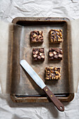 Short Bread Squares with Chocolate Candy Topping and Chocolate Chip Squares with Caramel Popcorn Topping